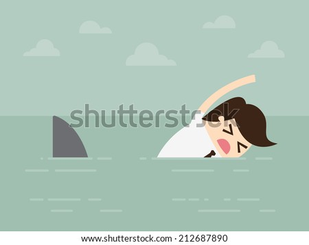 businessman swimming with shark