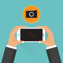 Businessman taking a photo from horizontal mobile phone
