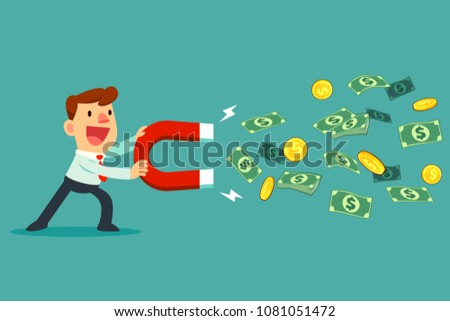 Businessman use large magnet to attract money. business concept.