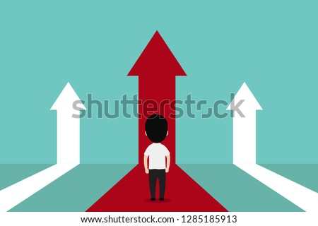 Businessman with choice arrows and navigation arrow on the surface. Concept of decision making and choices success in the future goal