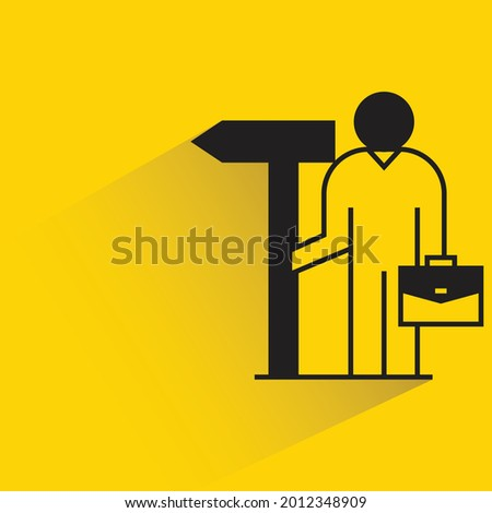 businessman with guidepost icon on yellow background Stock photo ©