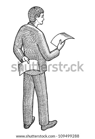 Businessman with two documents in hands