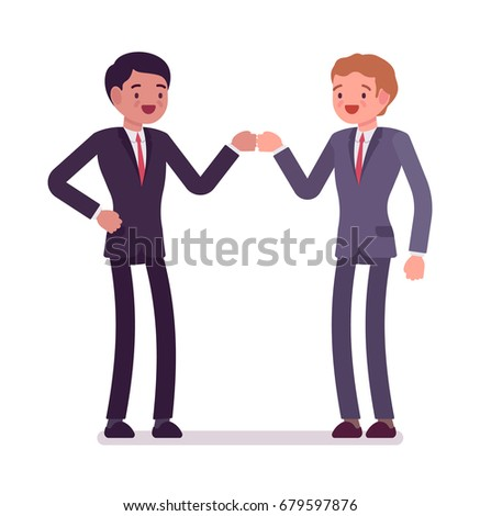 businessmen fist bump partners