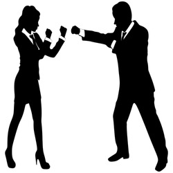 Businesswoman boxing with a young businessman