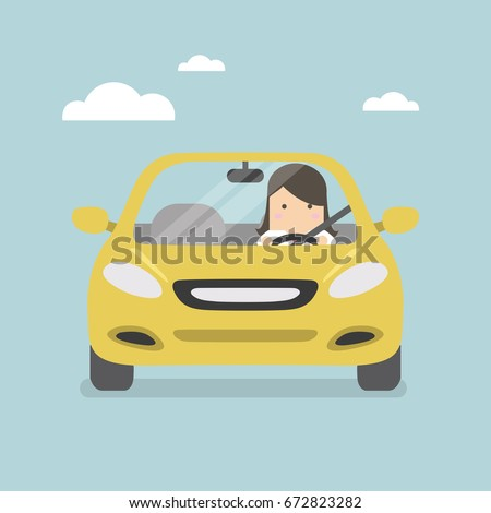 Businesswoman driving yellow car on the road