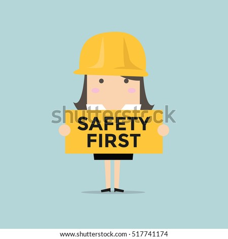 Businesswoman holding safety first sign vector