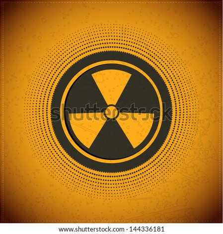 Button with radiation symbol