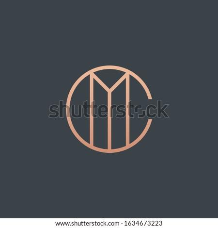 C & M monogram logo in copper color. Stock fotó ©