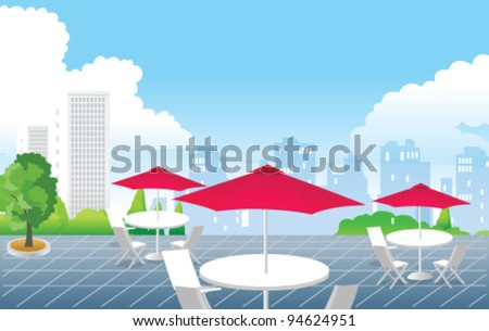 Cafe in front of city skyline
