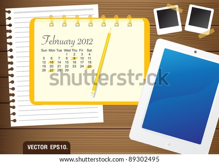 Calendar 2012 February on paper yellow Notebook.  With Fictitious touch tablet PC and photo frame. on brown wood background. Vector template for design work