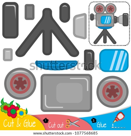 Camcorder. Device for recording a motion picture. Videocamera. Education paper game for preshool children. Vector illustration.