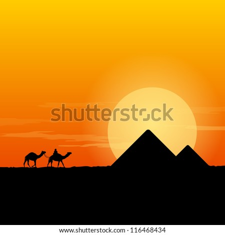 Camel Caravan and Pyramid - Desert scenery with pyramids and camels at sun dusk