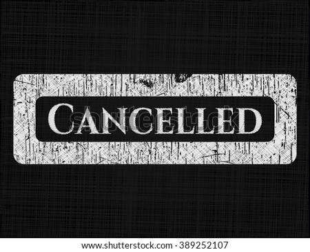 Cancelled chalkboard emblem written on a blackboard
