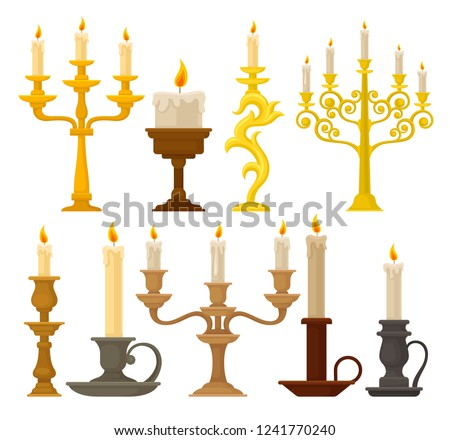 Candles in candlesticks set, vintage candle holders and candelabrums vector Illustration on a white background Stockfoto ©