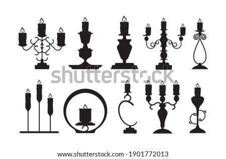Candlestick silhouettes. Black shapes of candelabrum with burning flame vector candle holders set Stockfoto ©