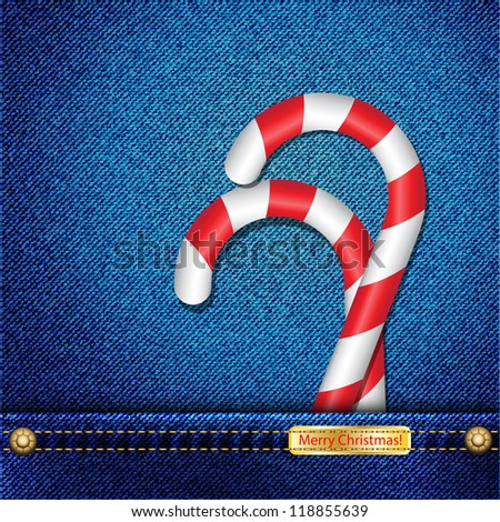 Candy canes in denim pocket and a tab wishing a Merry Christmas. EPS10 vector format.