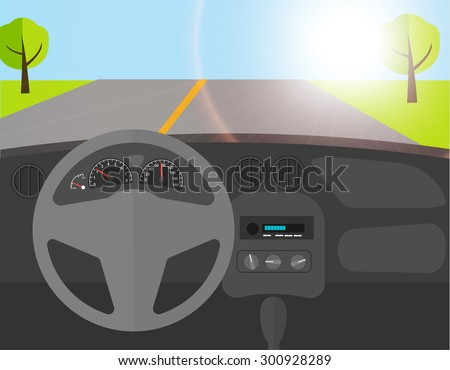car driving on an asphalt road