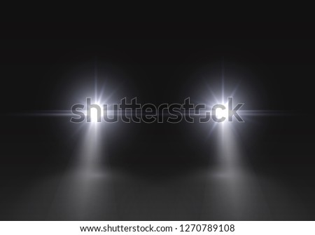Car headlights flares effect. Realistic white glow round headlight beams isolated on black gloom background. Vector bright car or train lights for your design.