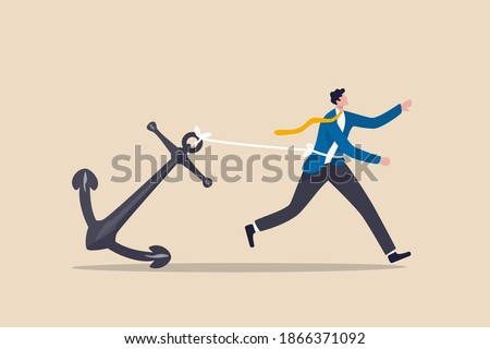 Career burden, held back or no career path in work, anchoring behavioral finance or hard work and struggle in business concept, tried stress businessman trying hard to run forward with heavy anchor. Stockfoto ©