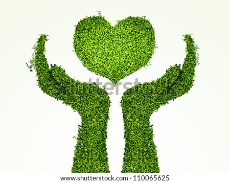 caring for the environment, arms out of the grass with his heart. The concept of ecology
