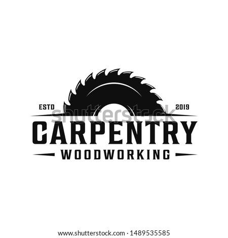 Carpentry, woodworking retro vintage logo design. Sawmill / saw logo Сток-фото ©