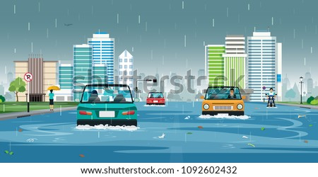 Cars are running on flooded streets in the city.