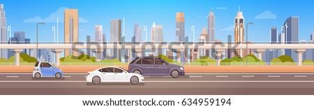 cars driving city street