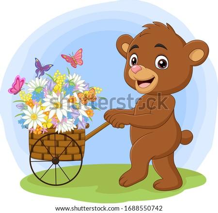 cartoon bear pushing cart full