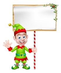 Cartoon Christmas Elf or Santa Christmas helper holding a blank sign