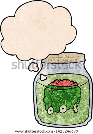 cartoon spooky brain in jar with thought bubble in grunge texture style #1423246679