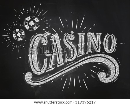 Casino sign with playing chips drawing with chalk on chalkboard