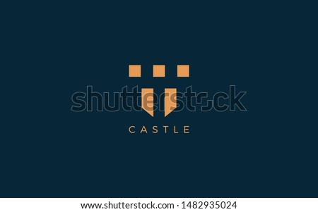 Castle logo with simple shape forms negative space of letter T  stock photo