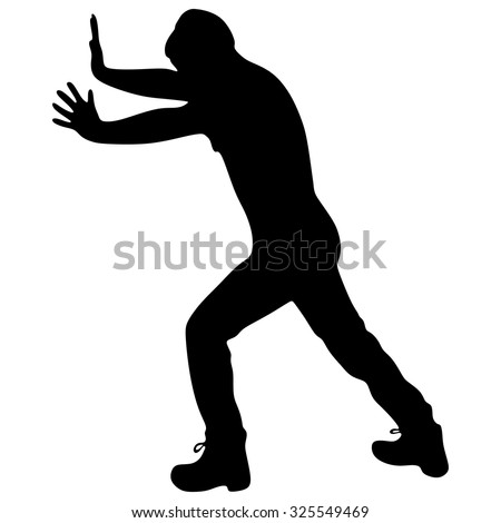 Casual man pushing a wall - isolated over a white background