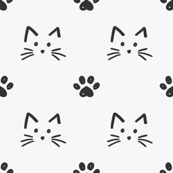 Cat faces and paws seamless pattern vector