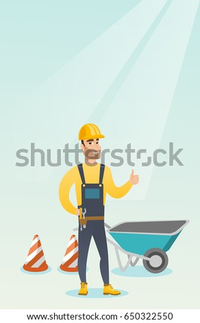 Caucasian builder with thumb up standing near wheelbarrow and traffic cones. Builder in hard hat giving thumb up. Builder at work on construction site. Vector flat design illustration. Vertical layout