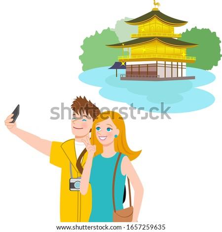 caucasian couple taking photos