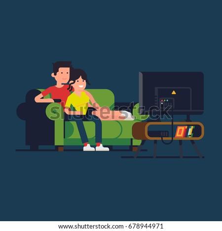 caucasian couple watching tv