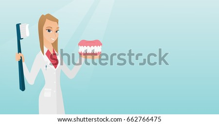 caucasian dentist showing a