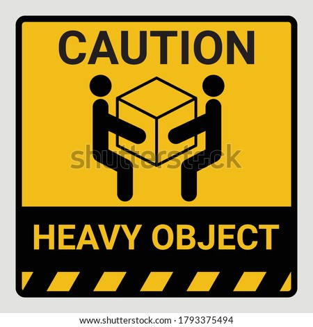 Caution heavy object two persons lift required symbol. Vector illustration of weight warning or beware sign cardboard isolated on gray Background. Label can be use on a box or packaging stock photo