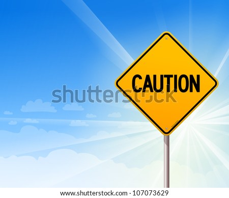 caution on blue sky background
