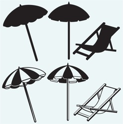 Chair and beach umbrella isolated on blue background