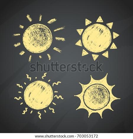 Chalk Drawings Of The Sun On a Chalkboard