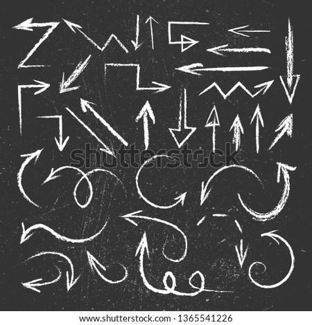 chalk drawn arrows set on blackboard