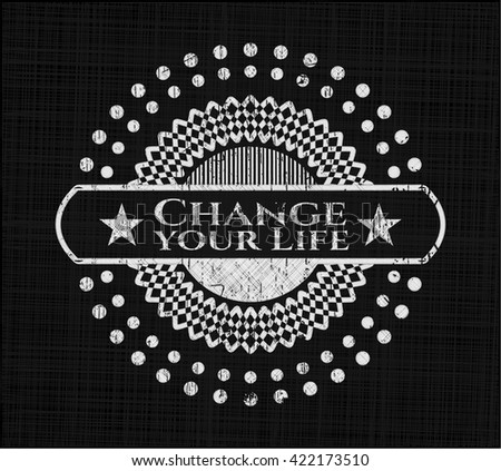 Change your Life chalk emblem written on a blackboard