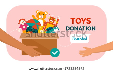 Charitable toys donation for kids: volunteer giving a donation box with lots of beautiful toys, solidarity and charity concept Foto stock ©