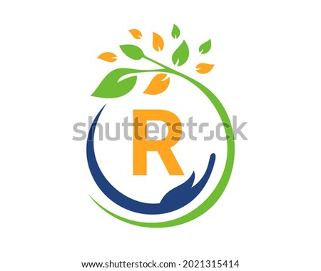 Charity logo with hand, leaf and R letter concept. Hand care foundation logo Photo stock ©