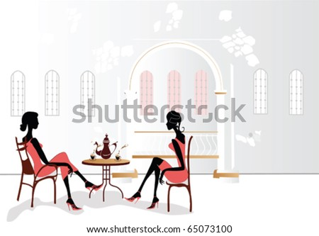 Chatting girls in the cafe