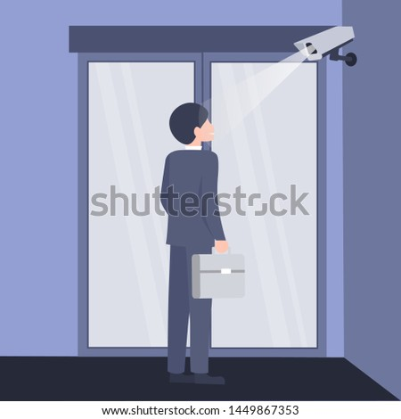 Checkpoint with a surveillance camera and system for the identification of people. Identification of businessman. Modern technology security. Scan at the input.  Biometric facial recognition system.