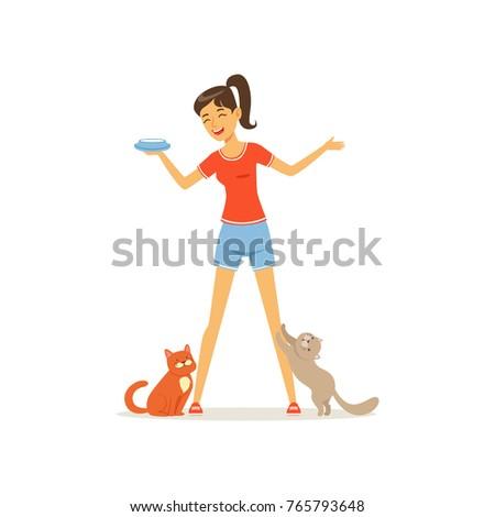 cheerful girl feed kittens milk