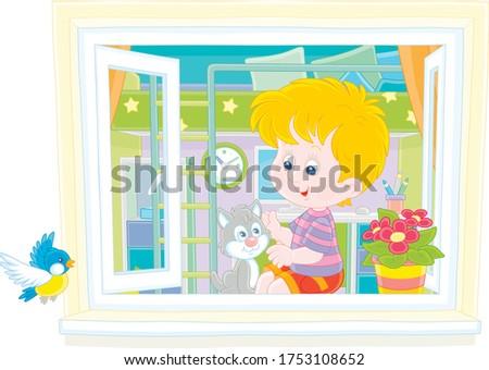 cheerful little boy playing